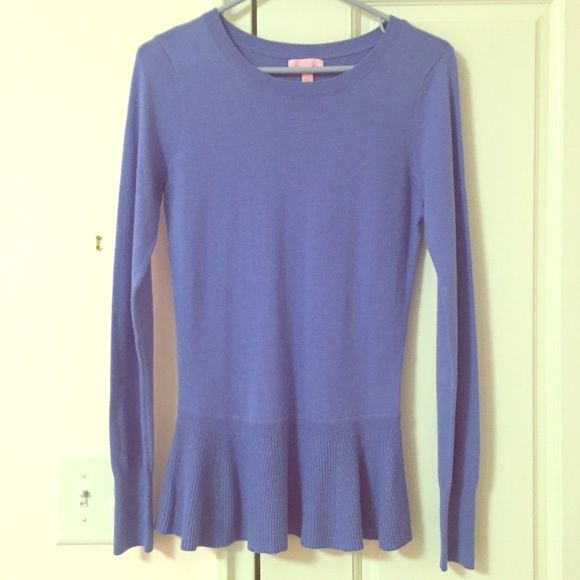 SALE! Lilly Pulitzer Cashmere Peplum Sweater MAKE ME AN OFFER! Beautiful soft sweater. Peplum bottom for a fun feminine and flattering touch. Fun buttons down the back for some flare. Size medium I personally feel it fits Between a small and medium. Perfect condition worn maybe twice. Always dry cleaned. No holes, no shrinking, no pulls. Great sweater. Lilly Pulitzer Sweaters