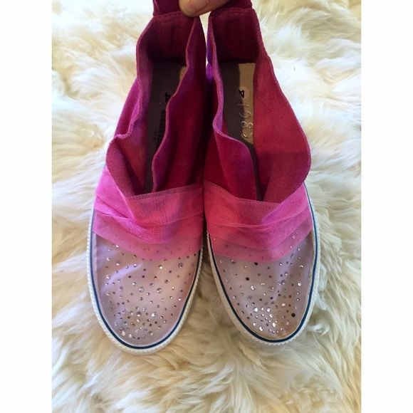 NWT Swarovski converse style pink suede shoe Bought in South Africa me never worn. NWT. Pink suede converse style shoe with Swarovski detail on sheer toe. One of a kind One of a kind Shoes