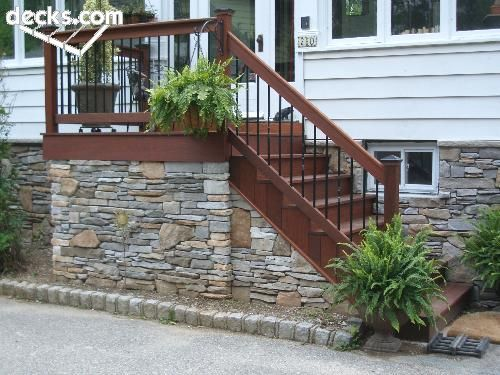 Custom ipe front porch with cultured stone skirting system below stone skirting available for - Fake brick skirting ...