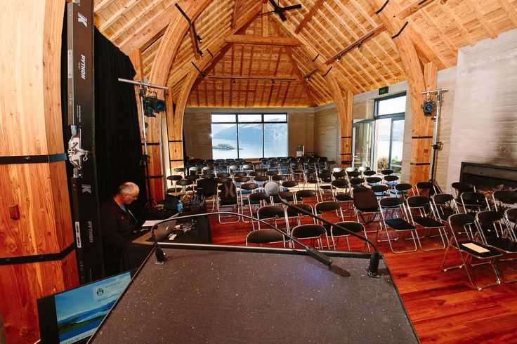 Standing at the lectern during a conference at The Rippon Hall, Lake Wanaka