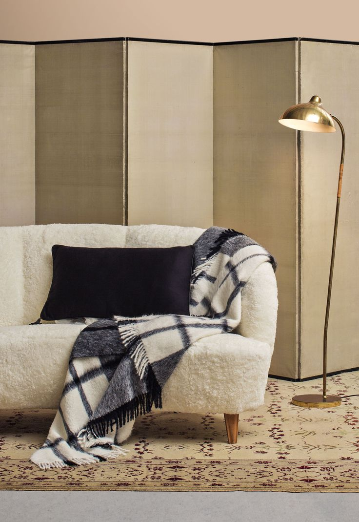 Relaxed elegance at home with alpaca plaid and cashmere and silk pillow. #Agnona #Home #FW16