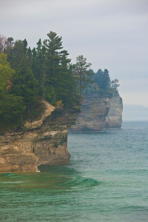 Spectacular cliffs in the mist at the west end of Chapel Beach along the North Country Trail, Pictured Rocks National Lakeshore, Upper Peninsula, Michigan.