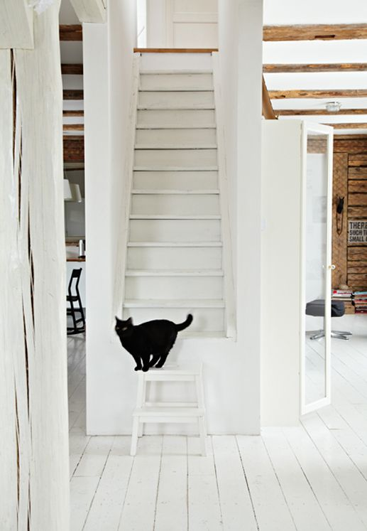 white-washed home and interesting staircase