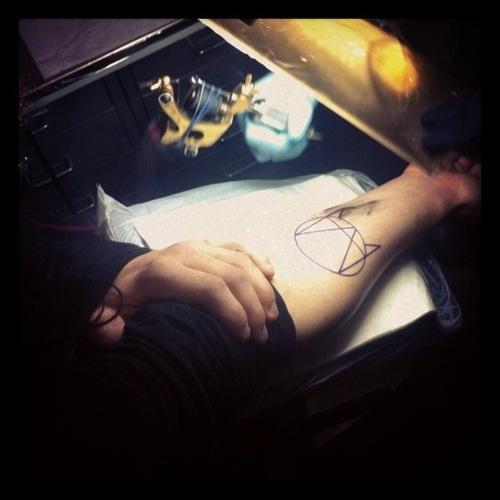 Sonny's OWSLA tattoo