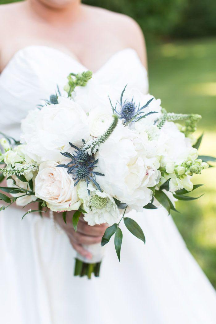 Elegant bridal bouquet with peonies, garden roses, anemones, blue thistle, and veronica  Autumn Creek Vineyards Wedding | Reidsville NC Event Planner - Leigh Pearce Weddings | Photo: Sara Logan Photography                                                                                                                                                                                 Plus