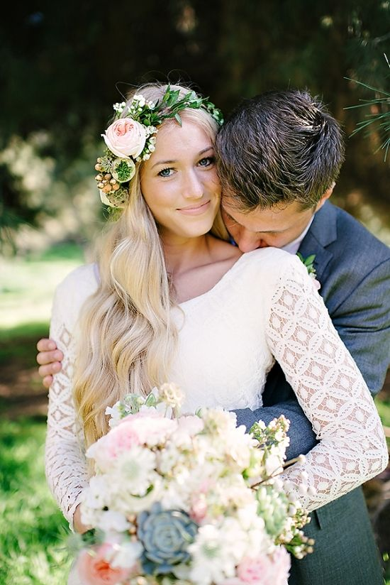 gorgeous all the way around. the flower crown, the wavy hair. the boho, lace-sleeved dress. and that big succulent in the middle of a romantic bouquet. love!