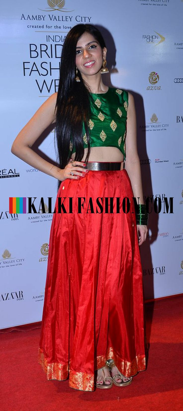 http://www.kalkifashion.com/ A celebrity in red and green attire attending the…