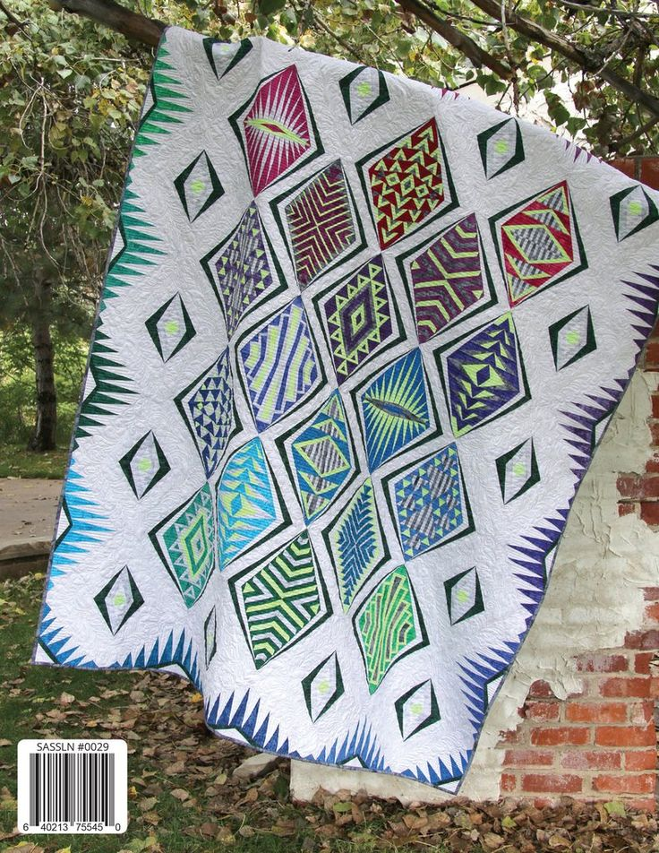 "Empire Place is a contemporary paper-pieced quilt inspired by the amazing Art Deco era. Nine different diamond block designs create this modern quilt pattern. The book includes full-size foundation, step-by-step paper piecing instructions, a coloring page and more! The Empire Place quilt finishes 72"" x 90"" and can be run as a block-of-the-month program. We suggest also purchasing an Empire Place Foundation Papers and an Add-a-Quarter ruler to make this quilt."
