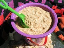 """Sand Cake Like dirt cake, sand cake is a layered dessert made with cream cheese, pudding and cookie crumbs. Be prepared to hear, """"Honey, why is there a pail of sand in the refrigerator?"""""""