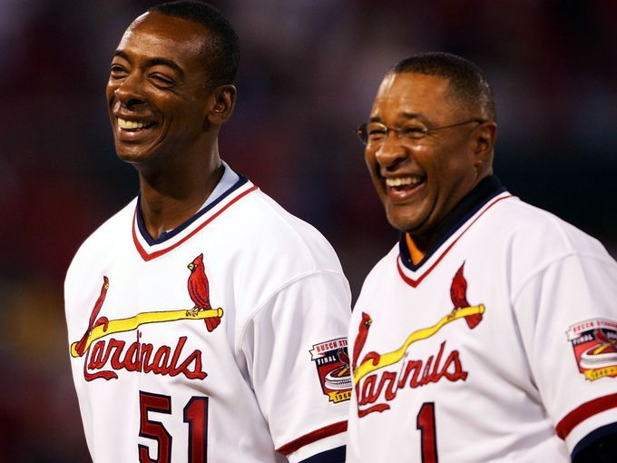 Ozzie Smith and Willie McGee of the 1985 Cardinals team stand on the field before a game on Sept. 30, 2005 at Busch Stadium.