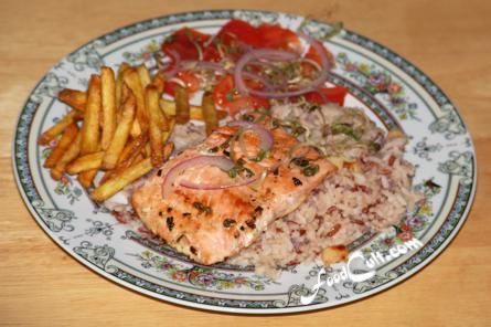 #Salmon is a wonderful source of #omega3 fatty acids. A small portion can go a long way set as an element in a this one-plate meal of pan-fried #salmon, rice (20 % cargo/red), and a small on-plate #tomatosalad, and fresh, #homemade #french-fries - #recipes, tips, and tricks @ http://wwww.foodcult.com  Galganov's Recipes and More - Food Matters!