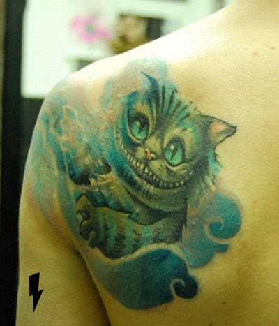 Thinking of getting my Cheshire cat tattoo added onto. I want the whole Cheshire cat face.