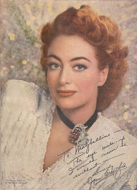 Joan Crawford looking marvelously fresh and gorgeous- a terrific image where the elegant side of her beauty is shown to perfection. Posign for this ad in 1946- she was triumphant about her recent Oscar, and it shows. The true color of her eyes remind us of just how lovely she could be. One of my favorite images of her ever and that's saying something!