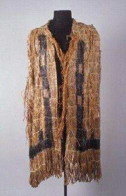 Cedar Bark Cape - Ethnology Collections Database - Burke Museum - Coast Salish, Puget Sound, Cedar Bark, Shredded, Twined, Raffia, Painted, Black