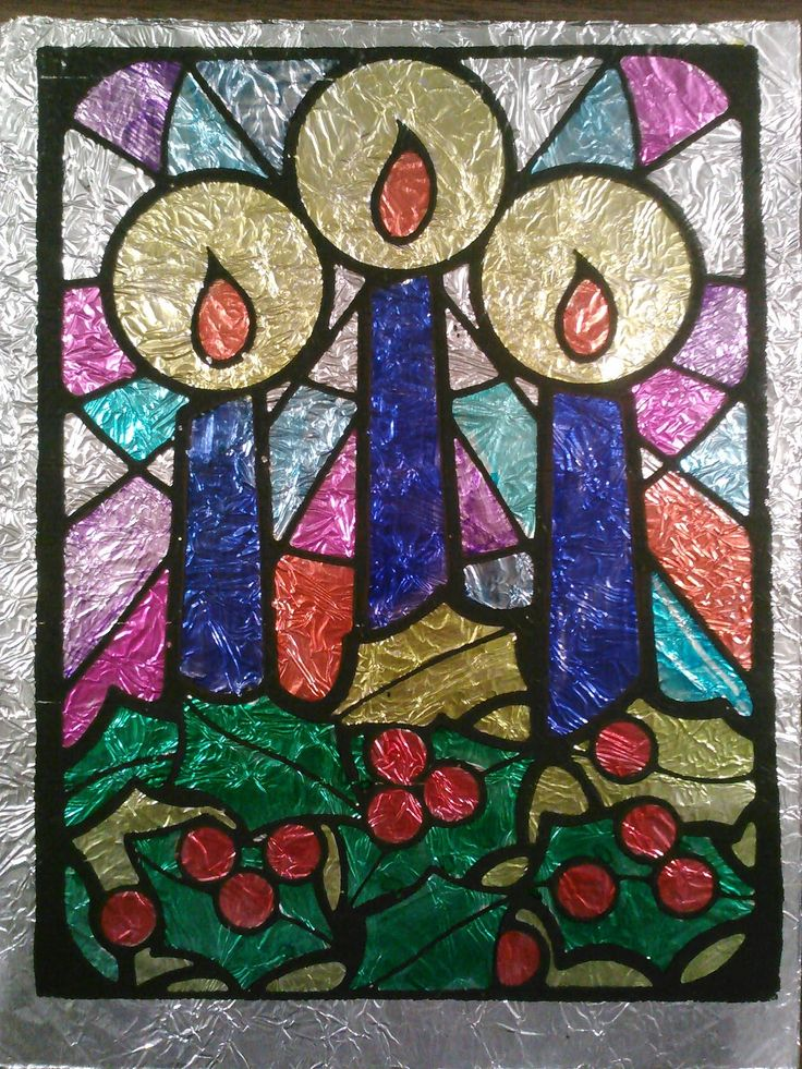 Do-it-yourself stained glass. Achieve this stained glass look with photocopier transparencies, foil and permanent markers. Instructions included.