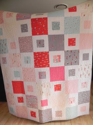 Moda Fabrics layer cake quilt.  I'm so making this quilt.  I love this fabric and the other quilt I made with turned out to be a disappointment.  I cut the fabric too small to be appreciated.