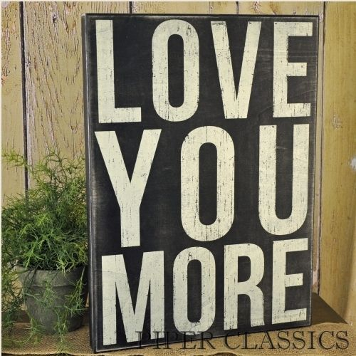 "Box Sign - Love You More,15"" x 21"" x 1.75"". These original box designs have a clever message stenciled on a black time-worn finish. The hollow back keeps them lightweight for easy display on a shelf or counter."