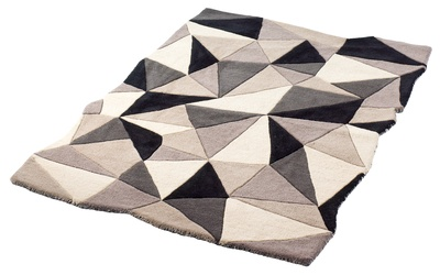 This hand tufted rug has a faceted design and will make a statement in any room.