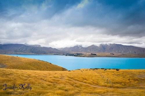 beautiful landscape of Lake Tekapo New Zealand.  The blue water is created by rock flour, this is suspended in the water therefore creating the stunning turquoise blue