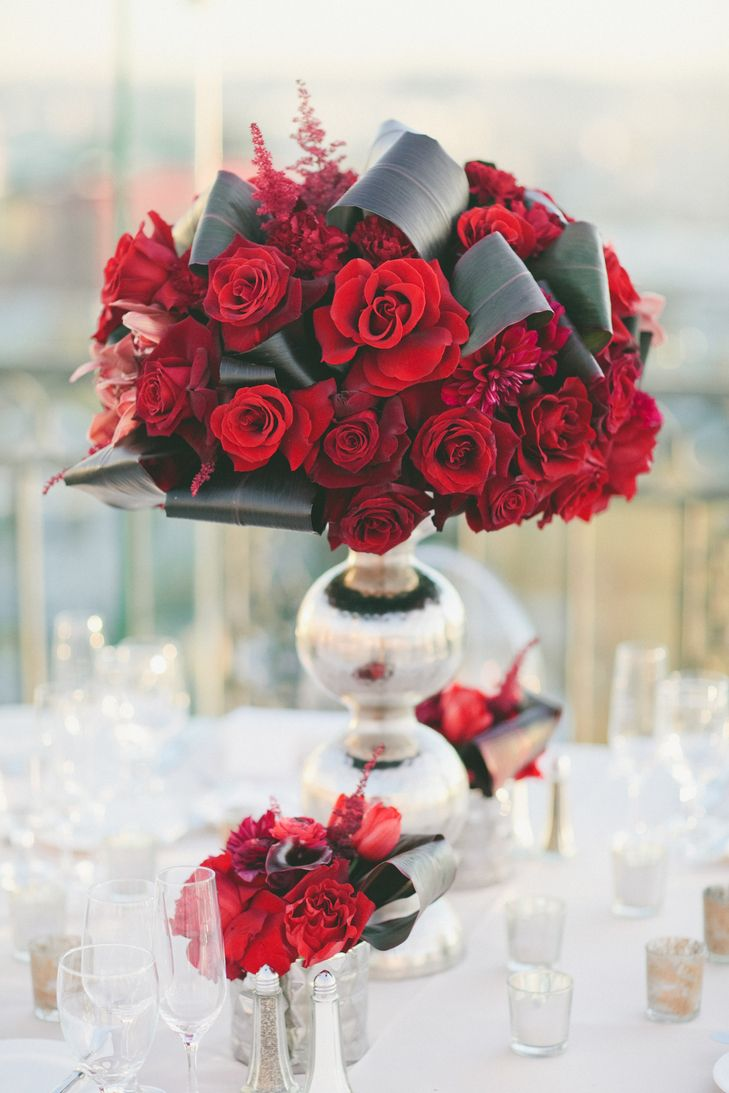 Modern red rose and banana leaf centerpieces onelove