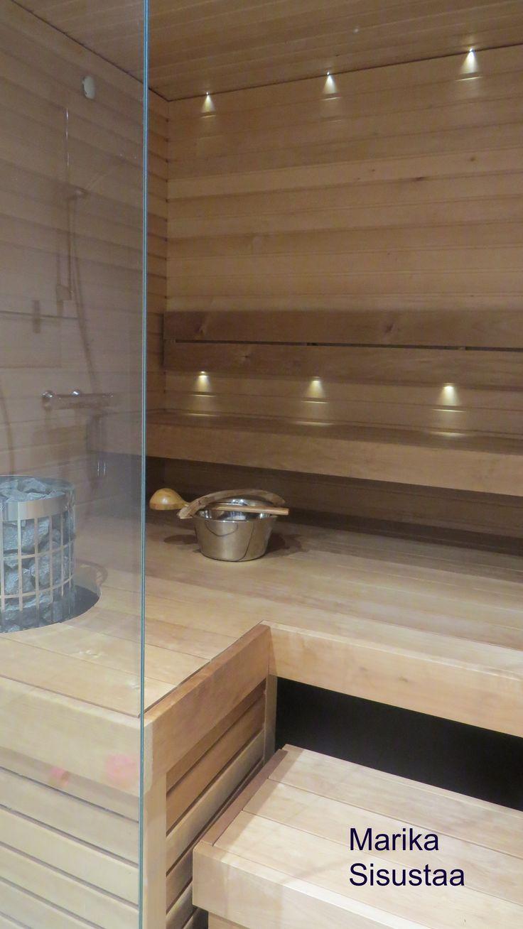 Moderni sauna, lasiseinä, tervaleppä