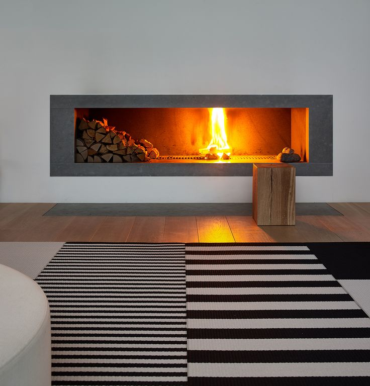 A stunning moment. Just the smooth warmth of the fire and cosy feeling. Woodnotes Big Stripe and Stripe carpets with the Squareplay combo. #interiordecor #interiordesign #homedecor #scandistyle #nordicinspiration #fireplace #modern #blackandwhite #design #carpet #rug