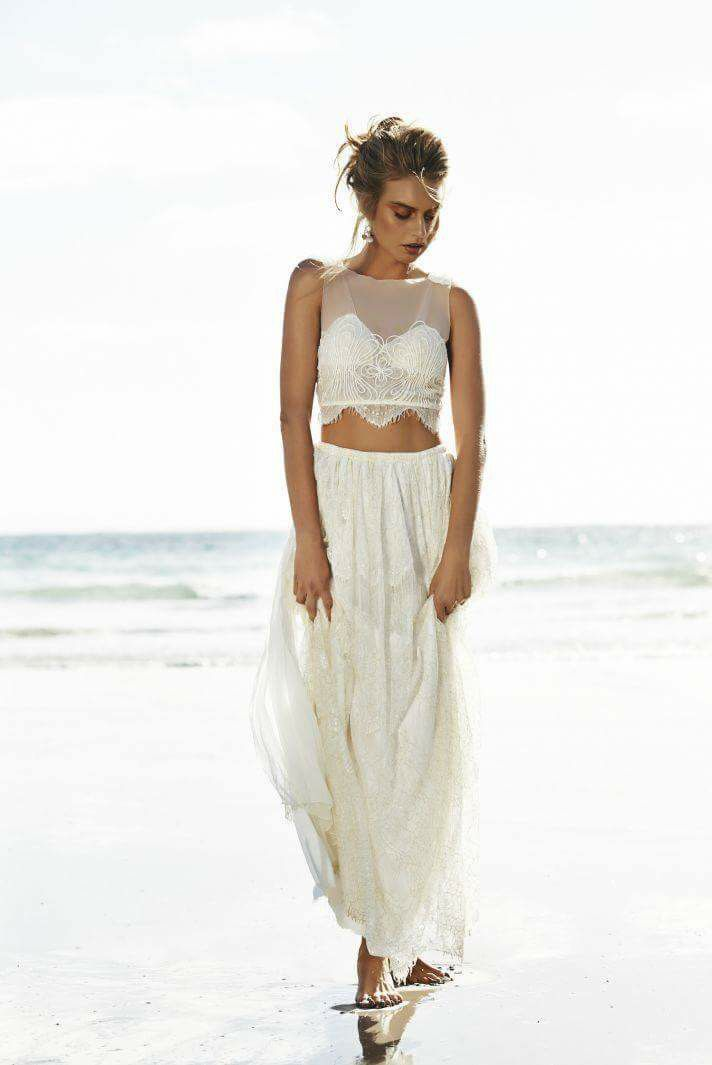 Beach wedding dress. Stunning two-piece wedding dress for the avante-garde bride. The AVRIL by Grace Loves Lace. Inspired by mermaids, the soft bustier features Chantilly lace with gold thread and built in shaped cups, corded embroidery, and eyelash lace scalloped hem. Purchase through our website www.graceloveslace.com.au