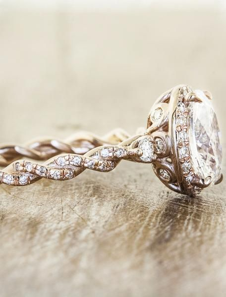 The Dory is a vintage-inspired oval engagement ring, with a 2.00ct oval center diamond and an entwined band.