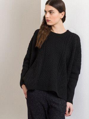 Jersey Frieda, corte asimétrico y efecto trenzado negro 80% lana merino