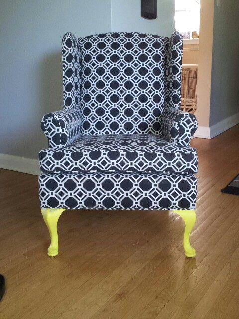 Black & White geometric wing back chair with yellow legs. www.tlginteriors.com