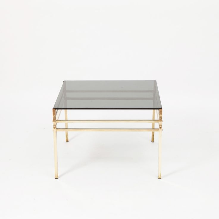 Circa 1960  A Hollywood Regency style elegant side table with brass structure and smoked-glass top.  SIZE  Width: 70 cm  Depth: 70 cm  Height: 50 cm  STOCK  1 Available