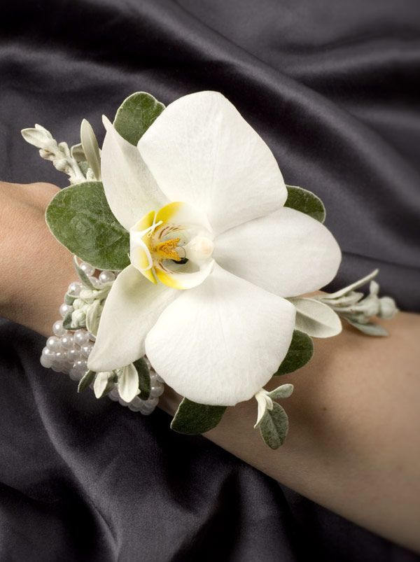 Simple orchid bracelet corsage. We have gold bracelet bases we can use.
