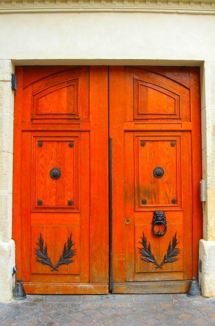 Bright orange doors in Paris, France~   ..rh