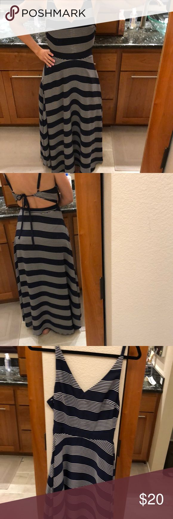 """Navy blue & white striped long dress Navy blue & white striped long flowy dress. Open back with tie. Side hidden zipper. Very minor flaw at chest, shown, not noticeable. Slight pulling at zipper area also shown. 57"""" long. 13"""" across waist. I am 5'5"""", 130 lbs for reference. Dresses Maxi"""