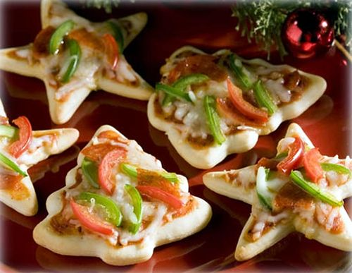 All you need are Christmas cookie cutters, pizza dough and your favorite toppings!  Super for your holiday buffet