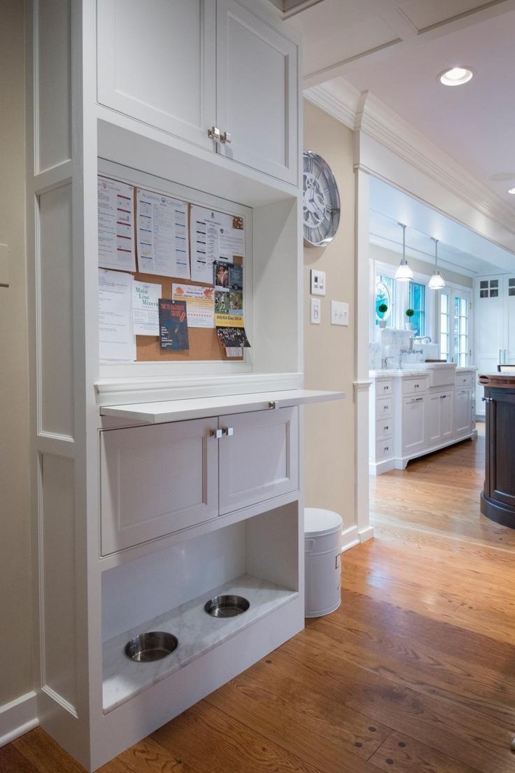This kitchen is equipped with a bulletin board, which is handy for keeping schedules, grocery notes and other reminders organized. Cabinets above and below provide extra storage, and food and water bowls are built-in for the family pet.
