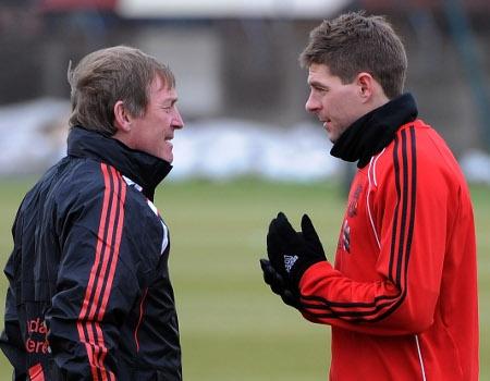 Kenny Dalglish having a chat with his skipper at Melwood