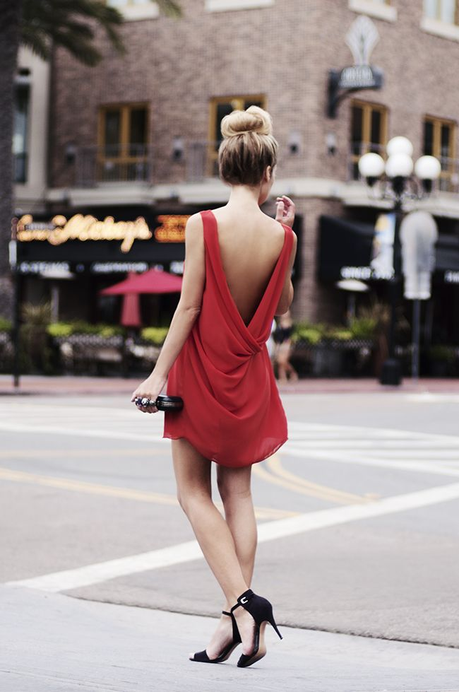 Red chiffon dress and Alexander McQueen knuckle clutch