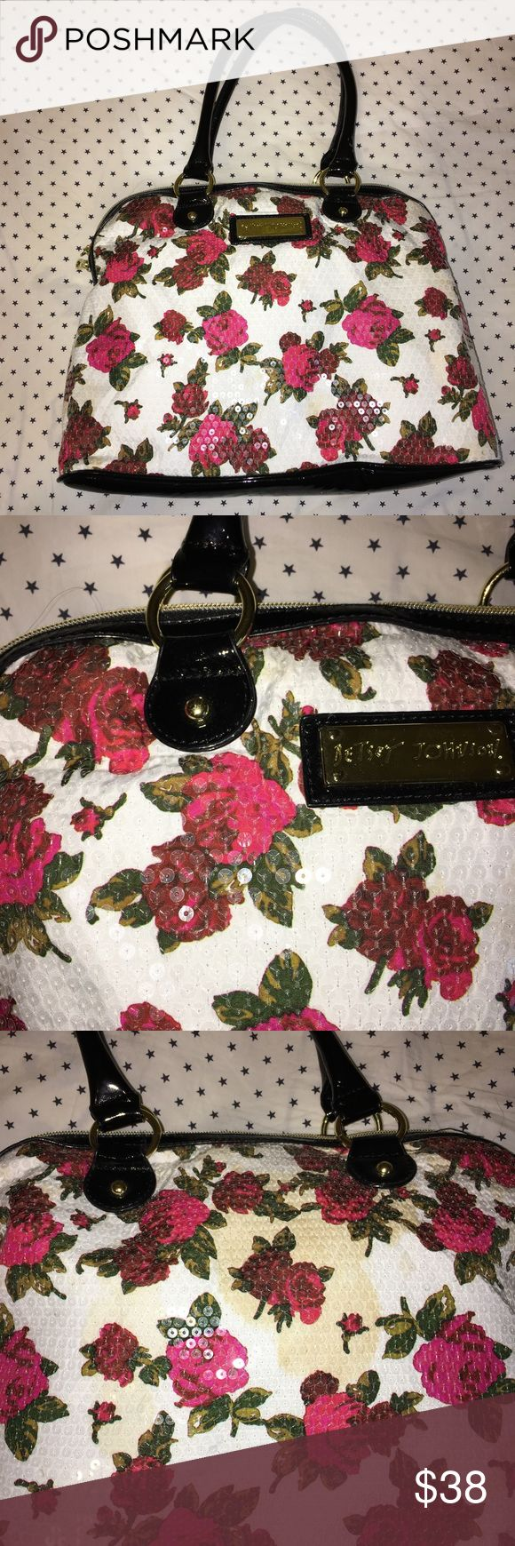 Floral Betsey Johnson Bag This bag looks great. The only flaw is a stain on the back. I think it can be easily washed off. It has sequins all over with black glossy straps.   * All items come from a smoke free & pet free home. * ALL REASONABLE OFFERS WELCOME! PLEASE GIVE ME YOUR OFFER.  * Items ship next business day. Betsey Johnson Bags Shoulder Bags