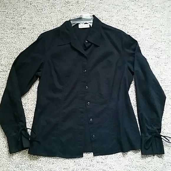 Lightweight Black Button-down Shirt Great black button down shirt with ties at cuffs for a subtle feminine touch. Lightweight material with slightly tailored fit. Apostrophe Tops Button Down Shirts