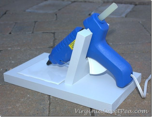 Make your own glue gun holder.  A square tile catches the glue drips keeping your crafting area neat and clean.