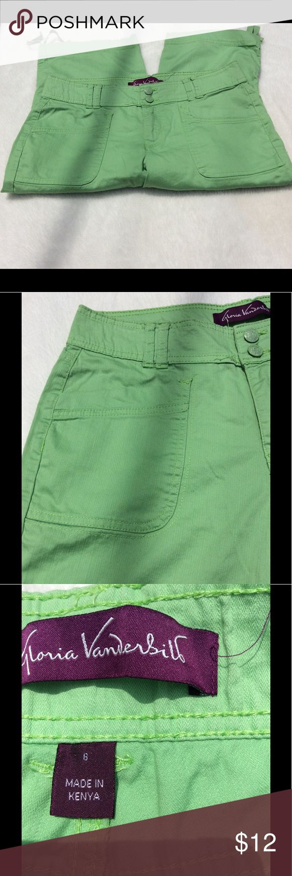 🆕Gloria Vanderbilt green stretch capris size 6 Gloria Vanderbilt green capris.  Two silver buttons in front as well as zipper closure. Two front pockets and two back pockets. Back pockets has embroidered designs on them. Wide legs with ties,  Has some stretch to them. Size 6. Note:  one minor flaw some loose threads in front of pants near waistline see last photo.   Materials:  97% cotton 3 % spandex  Measurements:  Length:  25 inches  Waist:  16 1/2 inches side to side  Inseam:  16 inches…