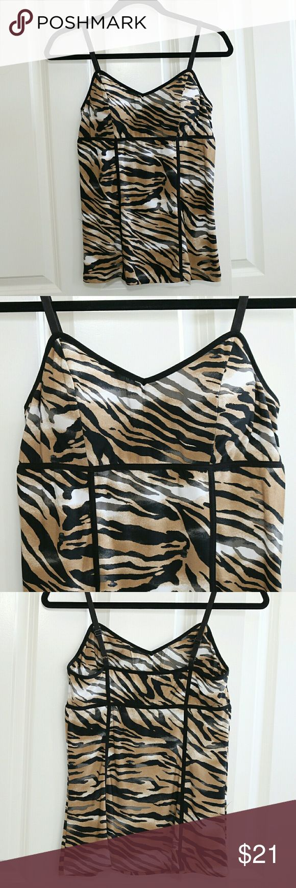 CACHE Animal Print Cami Tank CACHE animal print cami / tank with built in bra.? Size Medium.? About 15-16 inches from armpit to armpit.? Adjustable straps.? Poly/Spandex.? Previously owned but in excellent condition.? Little to no wear. Cache Tops Tank Tops