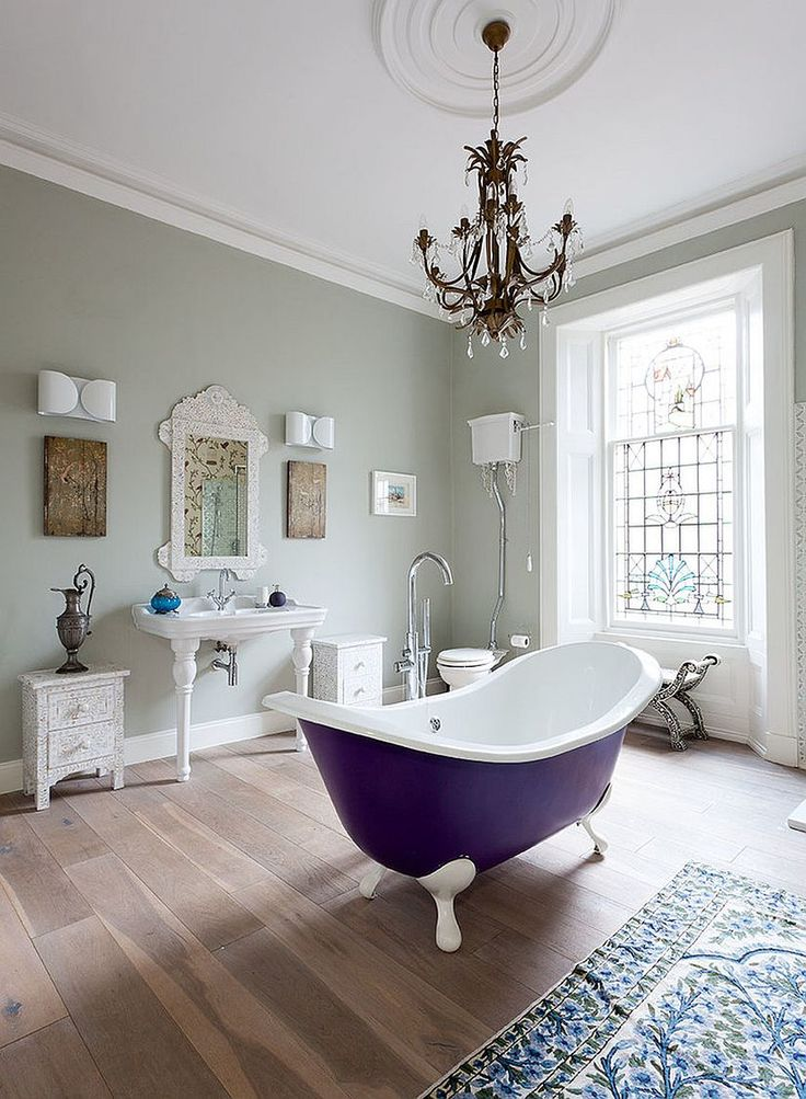 Victorian style bathroom with fabulous, bright standalone bathtub [Design: Cotterell & Co]