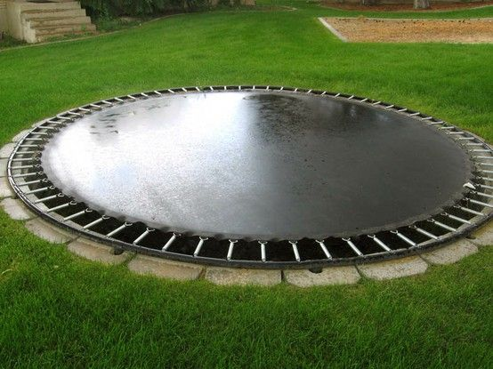 in-ground trampoline seems like a nice idea wonder how much trouble it would be to clean out that pit?