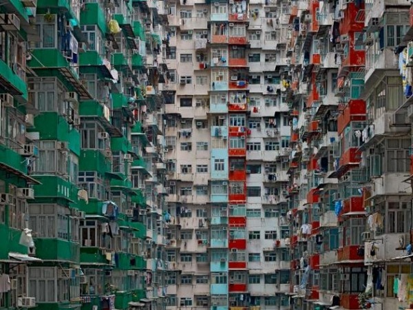 """German artist/photographer Michael Wolf's """"The Architecture of Density,"""" a wonderful photo essay that casts these rather generic and often neglected towers in an artful new light."""