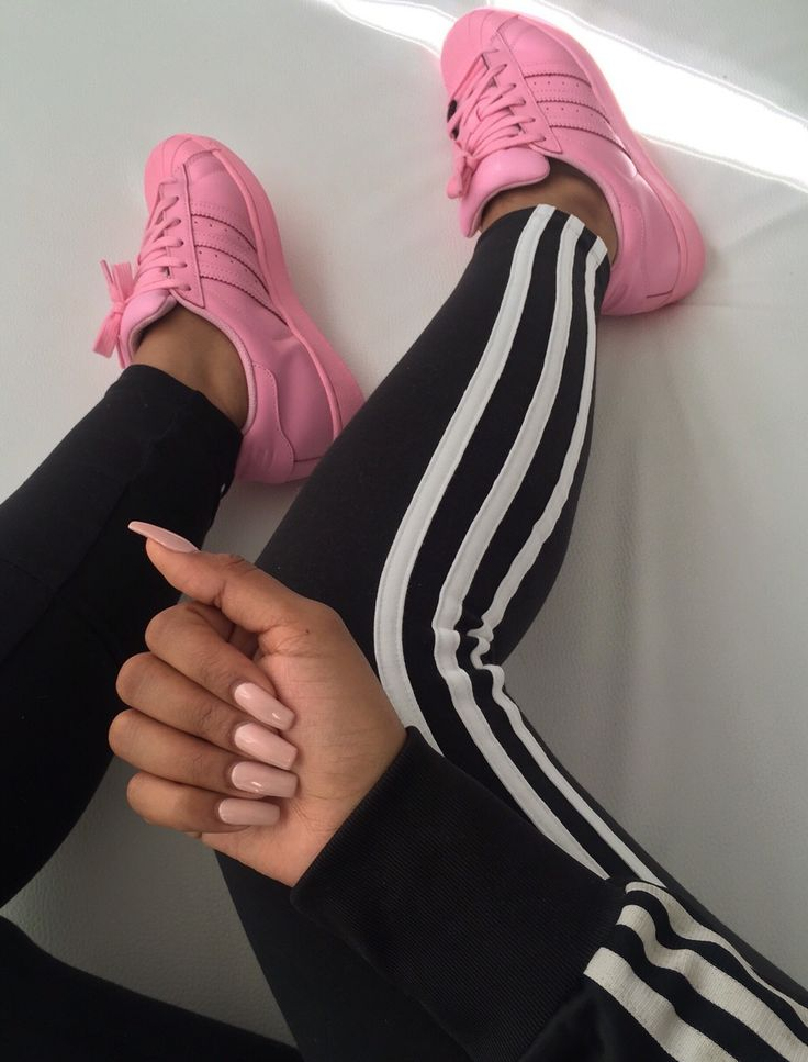 Pink Adidas sneakers and nude nail polish.