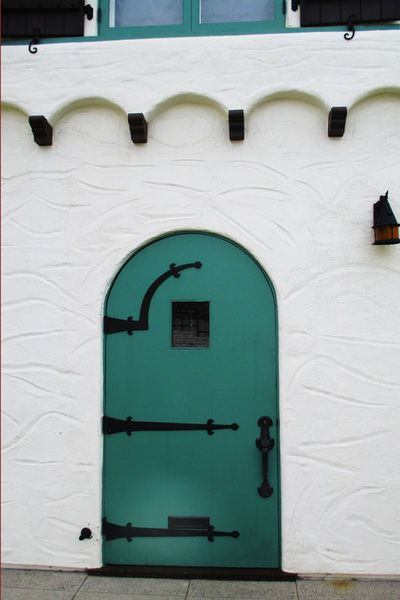 A perfect example of the correct shade of Spanish Green, or so called Moorish Green utilized on trim, doors and shutters.