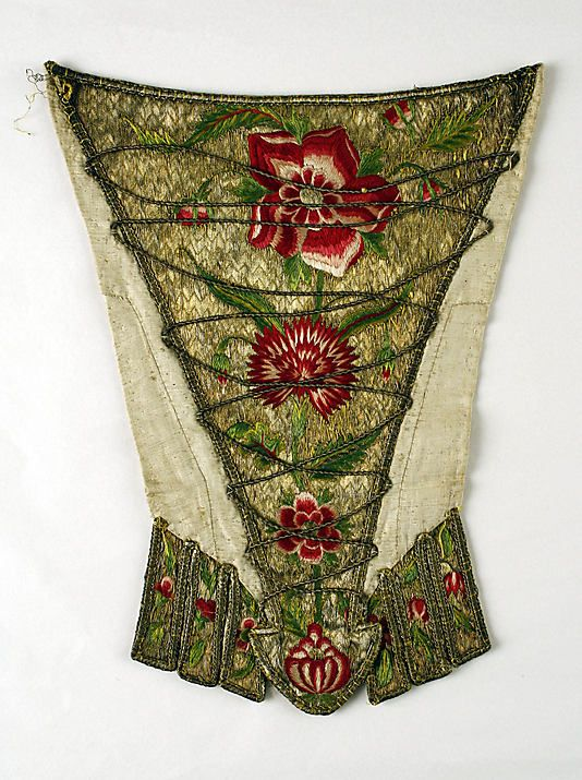 c1720 - Stomacher at Met Museum of Art - http://www.metmuseum.org/Collections/search-the-collections/80036015#    British - Metal, Silk & Flax Length 13 5/8 inches