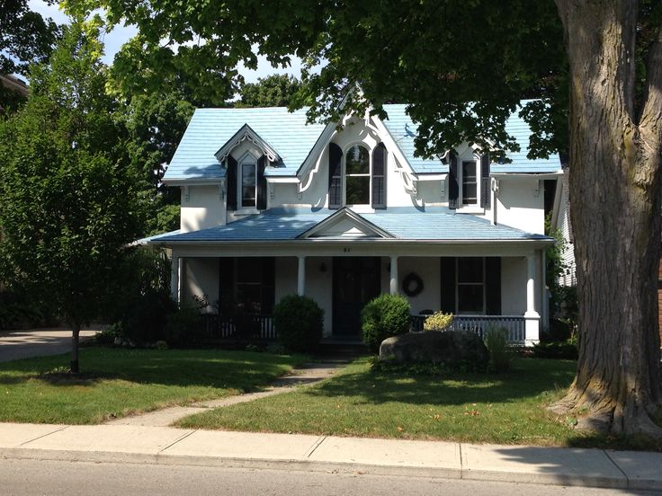 Another old beauty on my dog-walking route. I love the symmetry, colors, peaks and original shutters on this home.